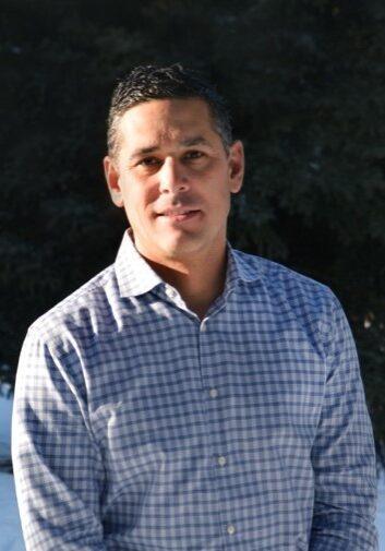 man wearing checked blue shirt