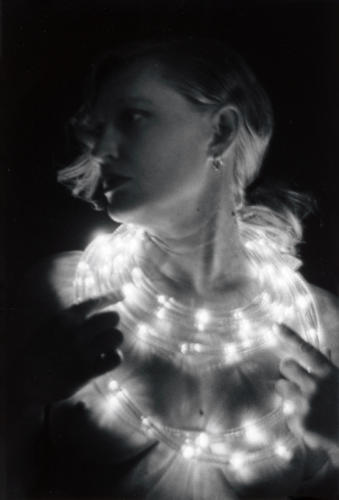 Woman in Light Necklaces (black and white, silver gelatin print)