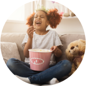 laughing-black-little-girl-watching-movie-at-home-JUD6ZTP