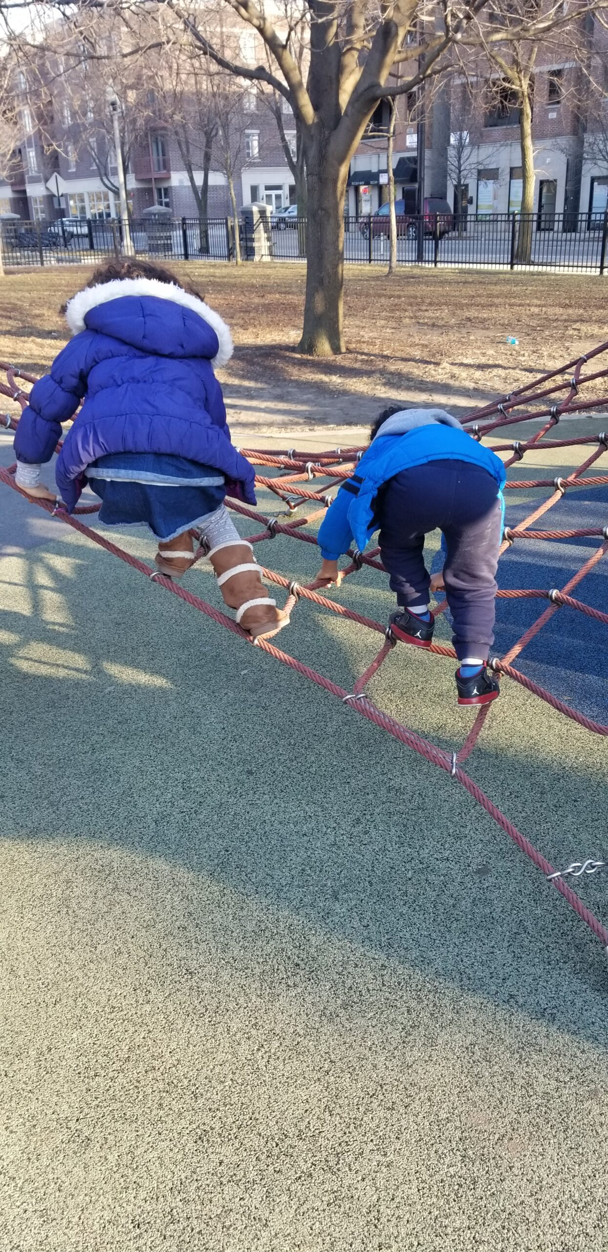 My children playing at a park near our home in Chicago