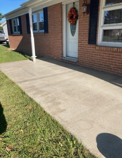 Image of the front sidewalk before work is done