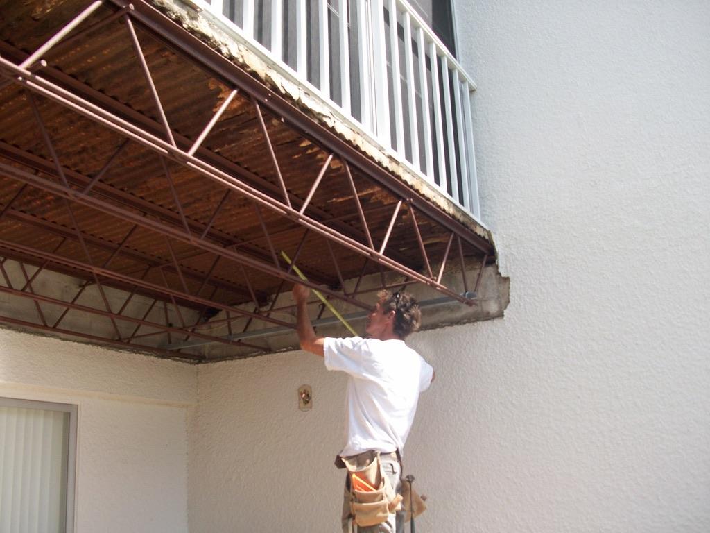 Man fixing balcony