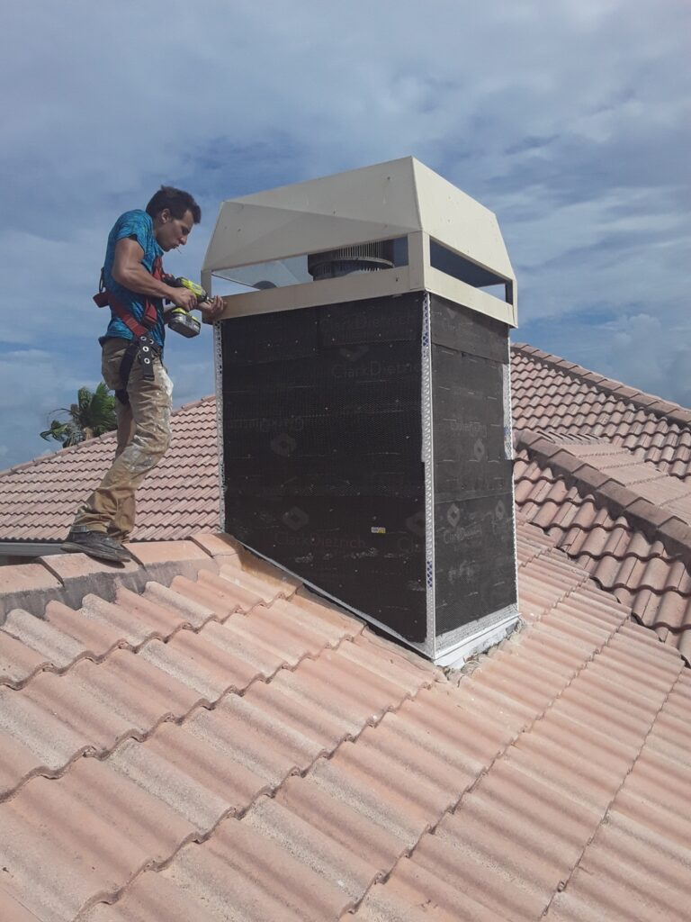 Man repairing stucco on chimney