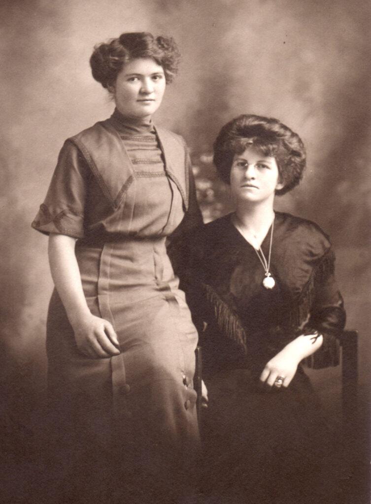 c. 1912 Clella standing, Cleo sitting