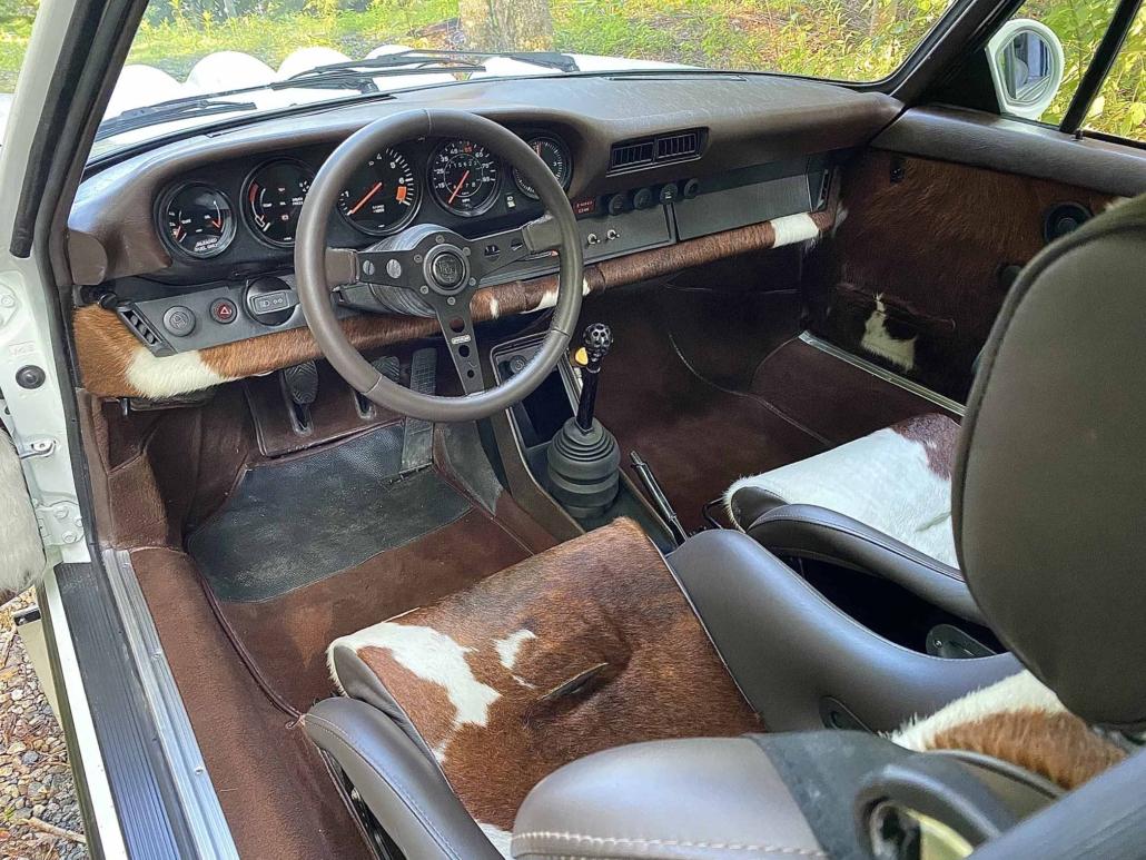 dash view of a Custom Built 1981 Porsche 911 SC with Grand Prix White exterior and Cow Interior