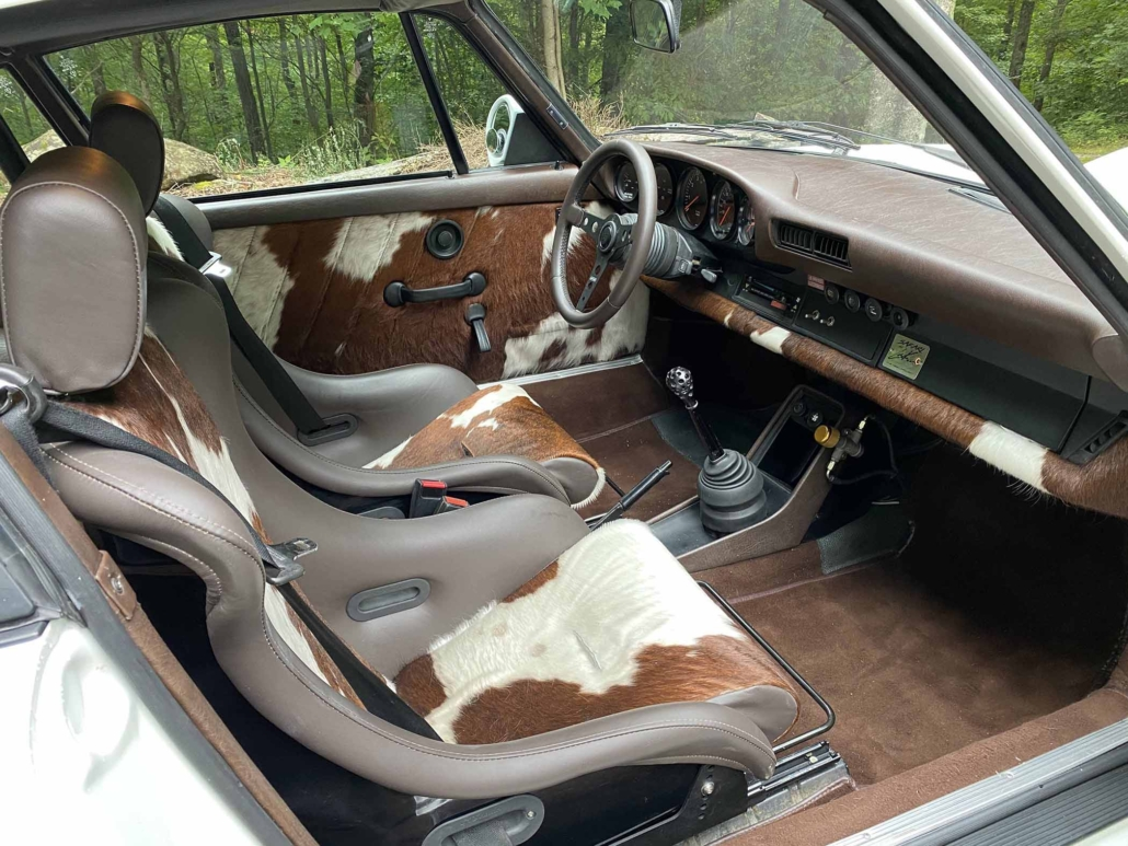 front interior view of a Custom Built 1981 Porsche 911 SC with Grand Prix White exterior and Cow Interior