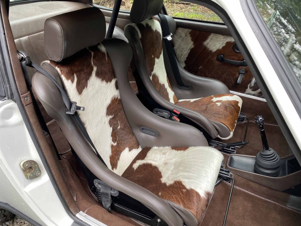 front seating on a Custom Built 1981 Porsche 911 SC with Grand Prix White exterior and Cow Interior