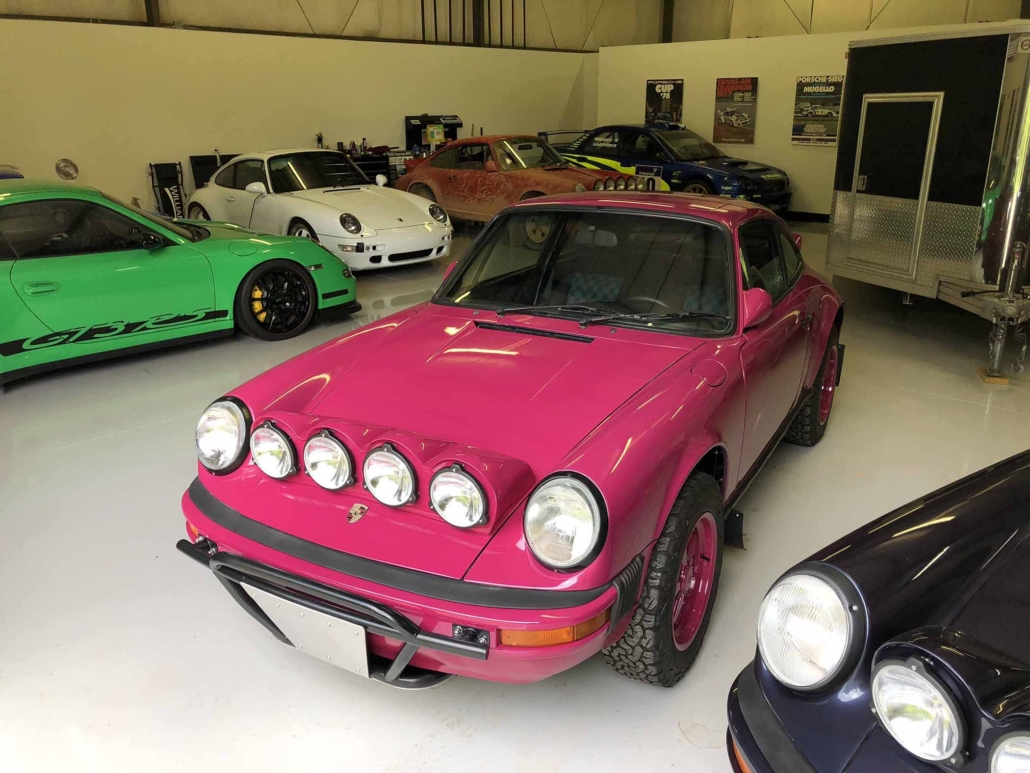 Custom Built 1988 Porsche 911 Carrera with Ruby Stone Exterior and Mercedes Fabric Interior parked in a garage