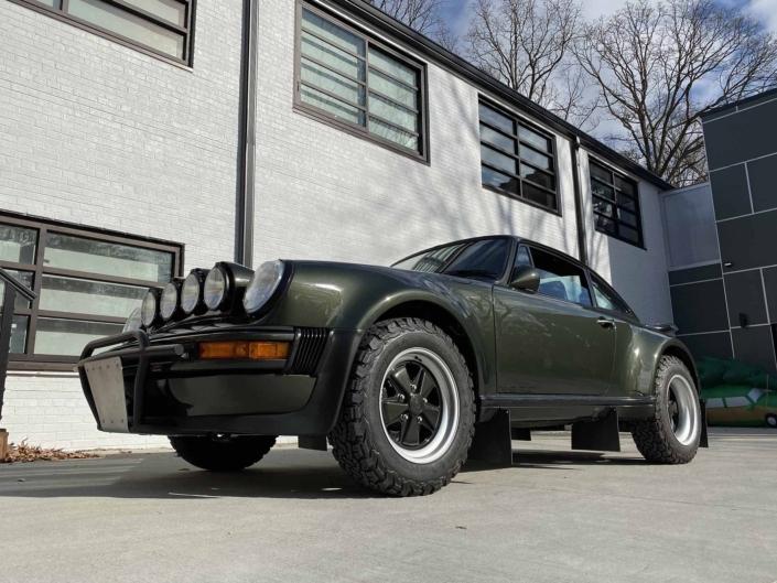 3/4 front view of a Custom Built 1986 Porsche 930 Turbo with Oak Green Metallic Exterior and Porsche tartan interior