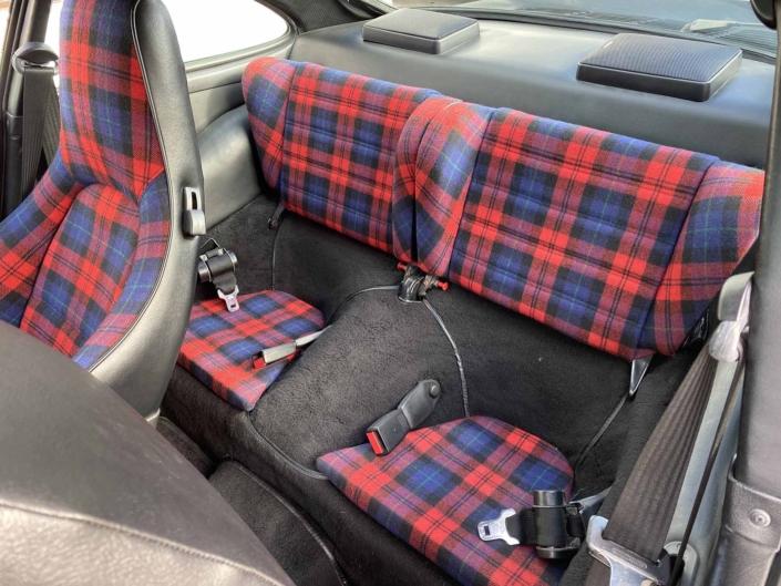 back seating on a Custom Built 1986 Porsche 930 Turbo with Oak Green Metallic Exterior and Porsche tartan interior