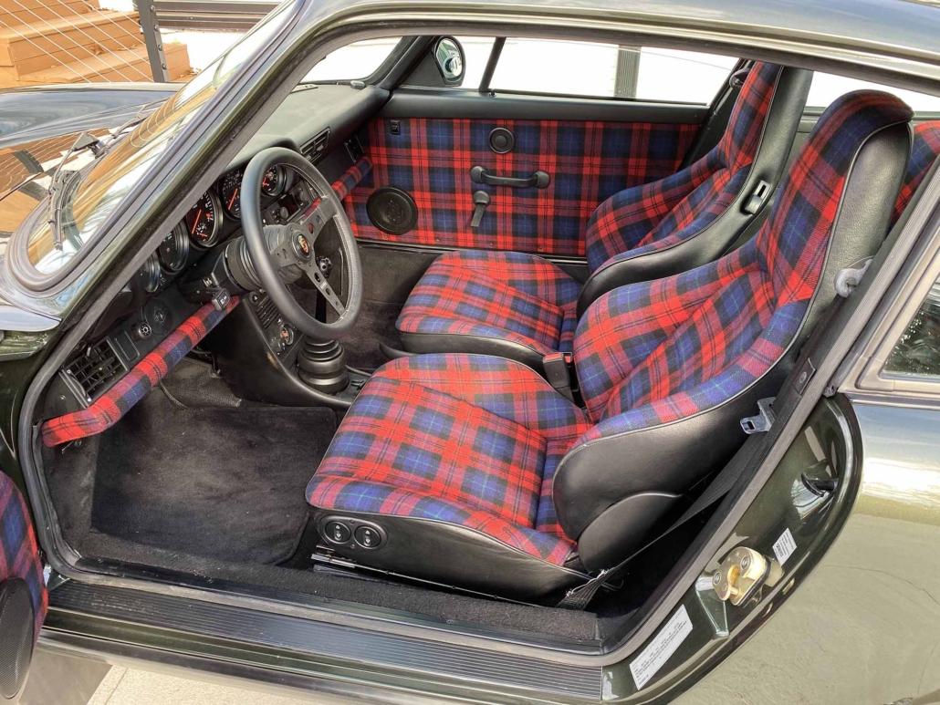 interior shot of a Custom Built 1986 Porsche 930 Turbo with Oak Green Metallic Exterior and Porsche tartan interior