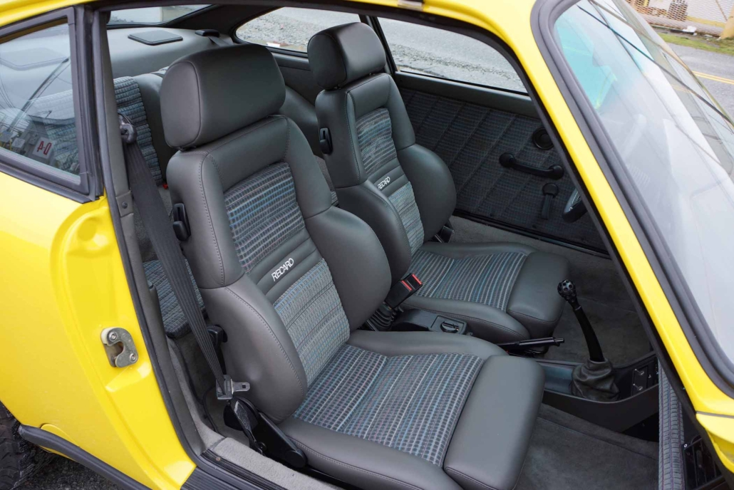 front seating in a Custom Built 1988 Porsche 911 Carrera with Cadmium Yellow exterior and Opel fabric interior