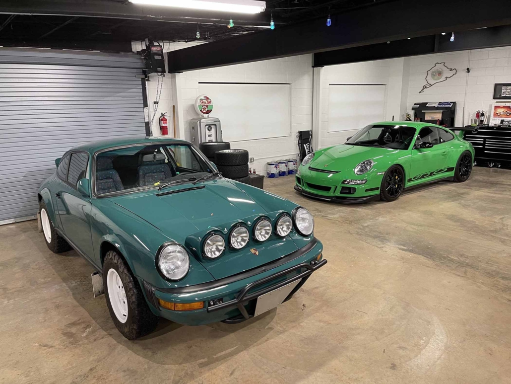 Custom Built 1974 Porsche 911 in Smyrna Green with Fiat fabric parked in front of the garage