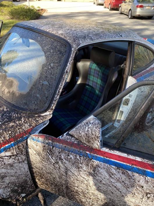 Custom Built 1982 Porsche 911 SC with Brumos Livery Exterior and Porsche Tartan Interior with the door open after going off roading