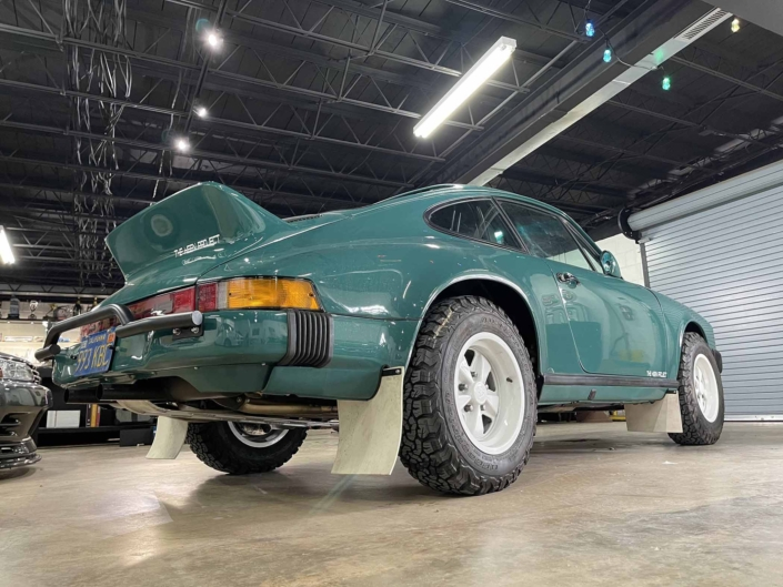 rear view of a Custom Built 1974 Porsche 911 in Smyrna Green with Fiat fabric