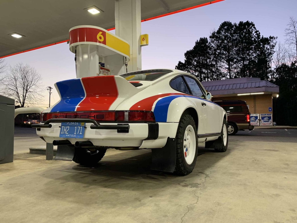 Custom Built 1982 Porsche 911 SC with Brumos Livery Exterior and Porsche Tartan Interior parked at a gas station