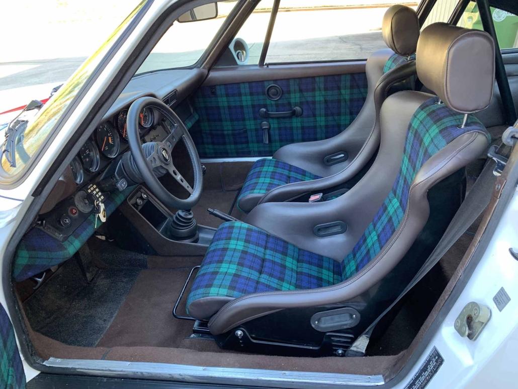 Custom Built 1982 Porsche 911 SC with Brumos Livery Exterior and Porsche Tartan Interior with the door open showcasing the custom interior