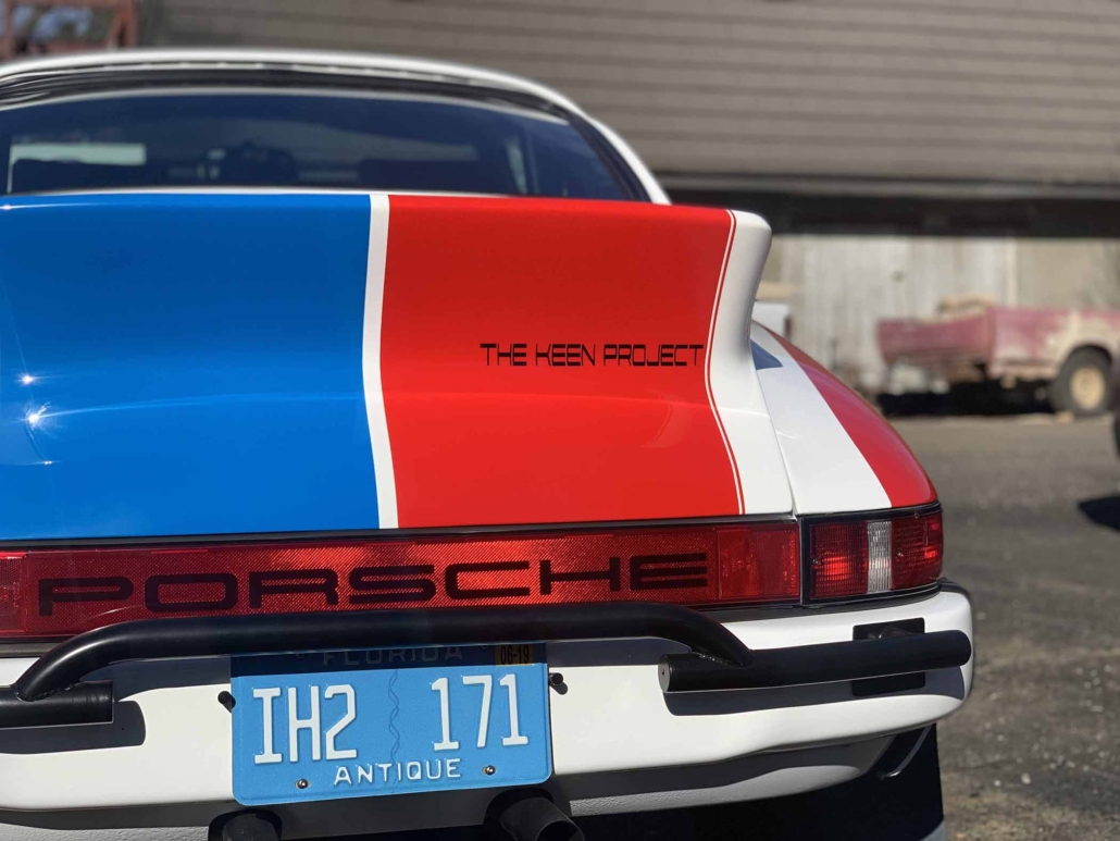 rear view of a Custom Built 1982 Porsche 911 SC with Brumos Livery Exterior and Porsche Tartan Interior