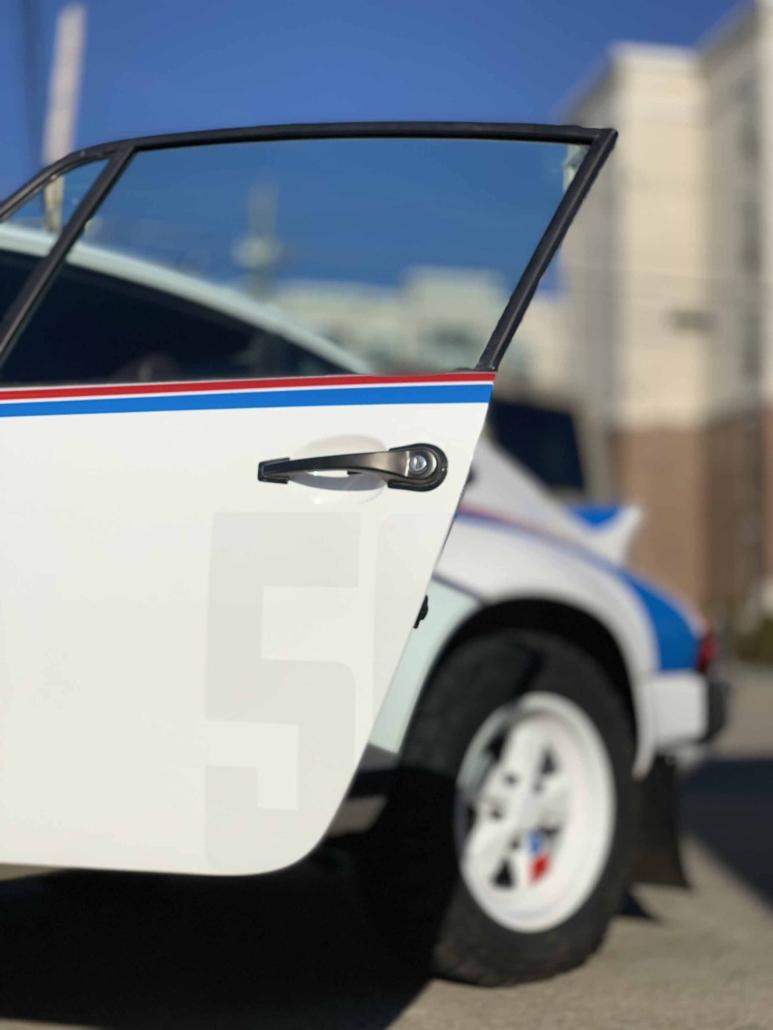Custom Built 1982 Porsche 911 SC with Brumos Livery Exterior and Porsche Tartan Interior with the door open