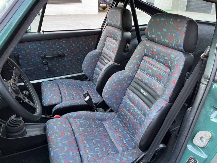 custom front seating on a 1974 Porsche 911 in Smyrna Green with Fiat fabric