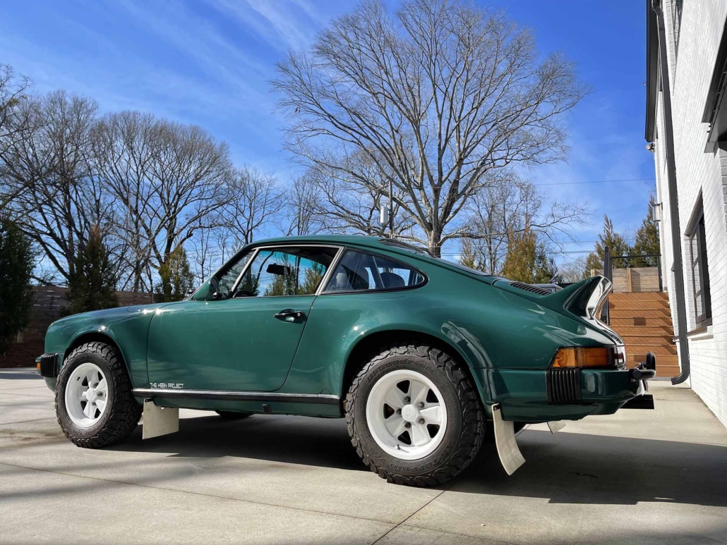 side view of a Custom Built 1974 Porsche 911 in Smyrna Green with Fiat fabric