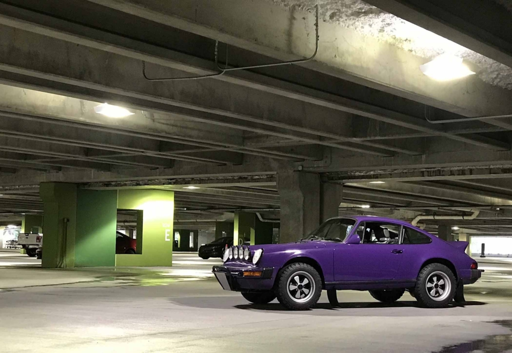 Custom Built 1978 Porsche 911 SC with Lilac exterior and Pascha interior parked in a parking garage