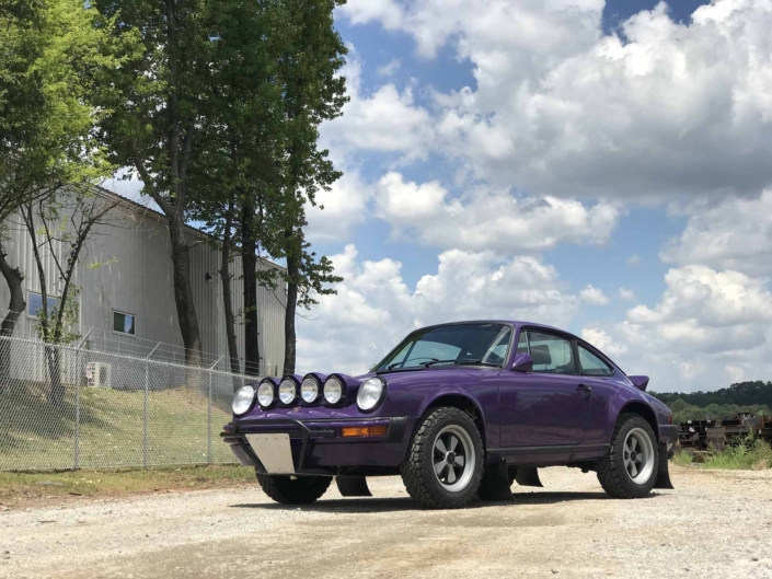 Custom Built 1978 Porsche 911 SC with Lilac exterior and Pascha interior parked on a dirt driveway