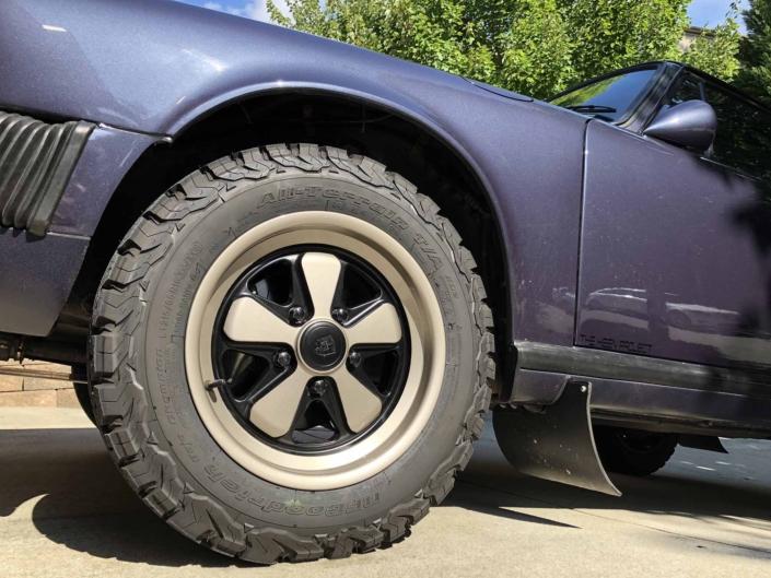 tire shot of Custom Built 1986 Porsche 911 Carrera Euro with Prussian Blue Exterior and Porsche Studio Check Interior