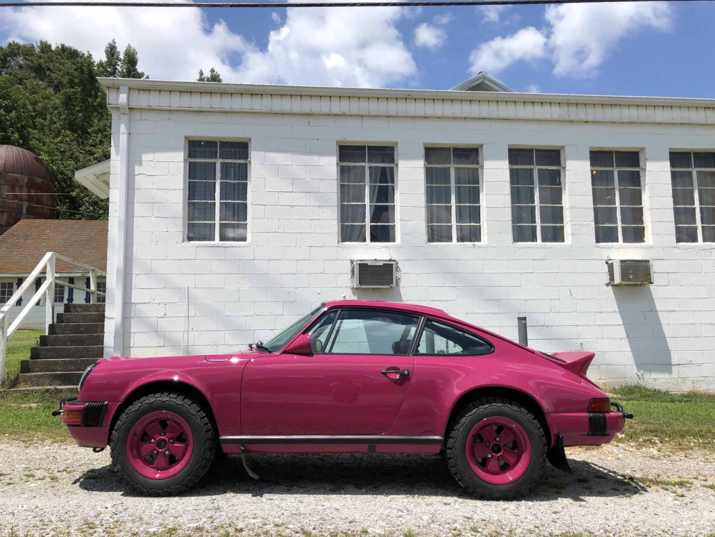 side view of Leh Keen's Custom Built 1988 Porsche 911 Carrera with Ruby Stone Exterior and Mercedes Fabric Interior