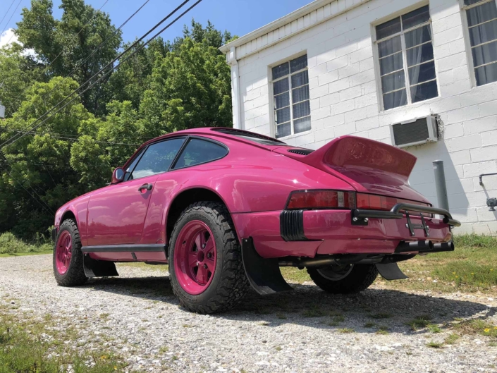 3/4 rear view of a Custom Built 1988 Porsche 911 Carrera with Ruby Stone Exterior and Mercedes Fabric Interior
