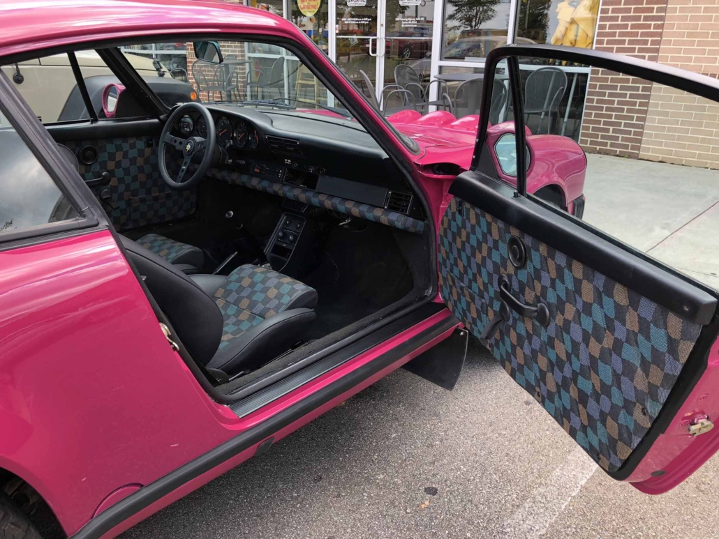 Custom Built 1988 Porsche 911 Carrera with Ruby Stone Exterior and Mercedes Fabric Interior with the door open