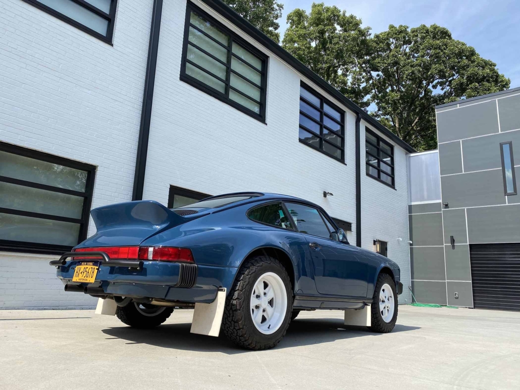 3/4 rear view of a Custom Built 1987 Porsche 911 Carrera with Aga Blue exterior and Carrera fabric interior