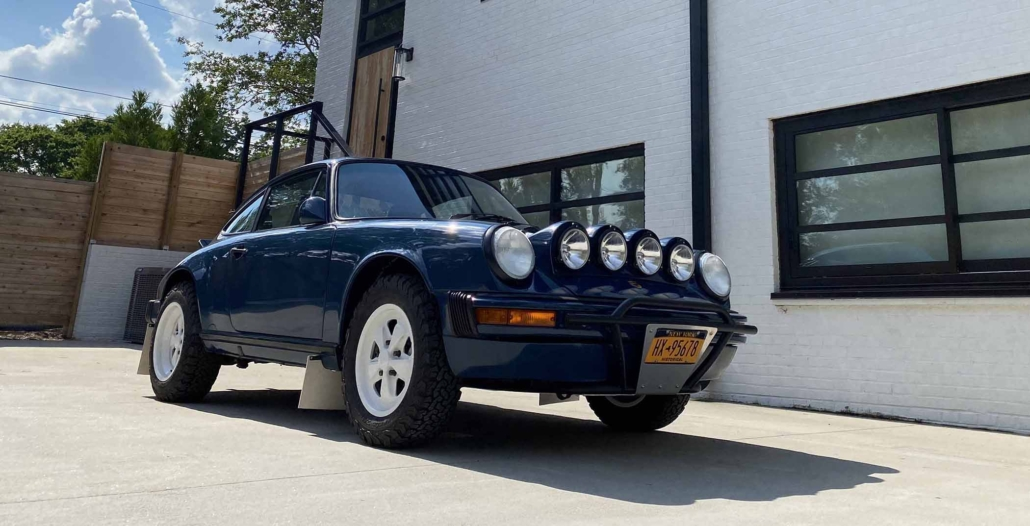 Custom Built 1987 Porsche 911 Carrera with Aga Blue exterior and Carrera fabric interior parked in front of a modern house