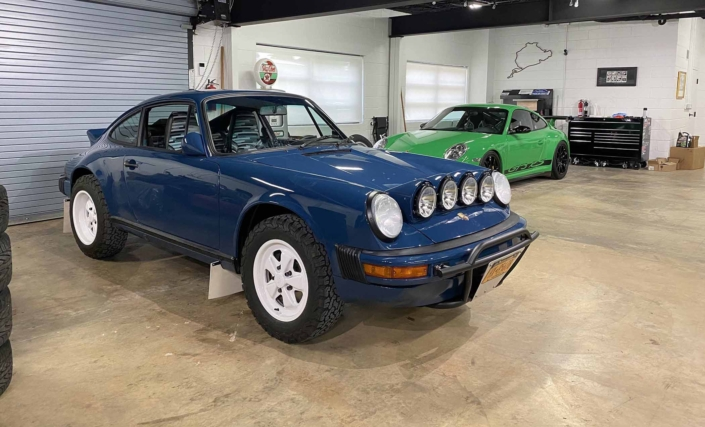 Custom Built 1987 Porsche 911 Carrera with Aga Blue exterior and Carrera fabric interior parked in a garage