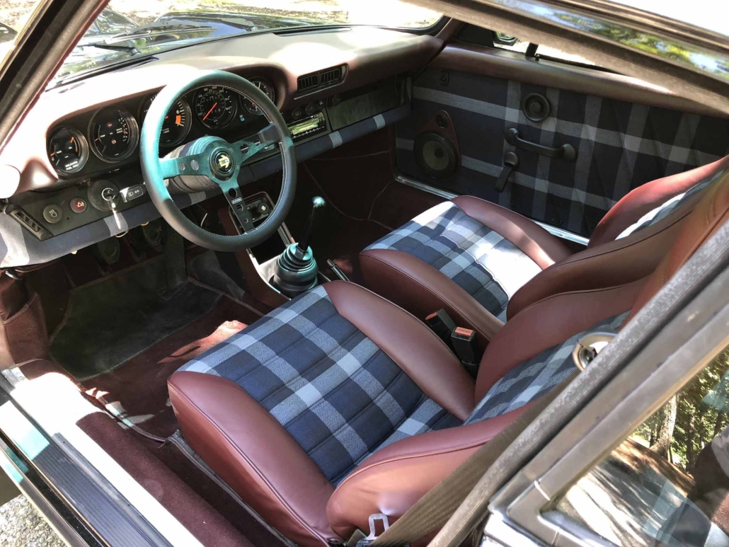 front seating of Leh Keen's Custom Built 1986 Porsche 911 Carrera with Shwartz Exterior and Mercedes G Fabric Interior