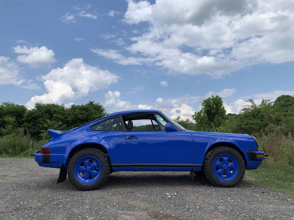 side view of a Custom Built 1988 Porsche 911 Carrera in Acid Blue with Dog fabric interior
