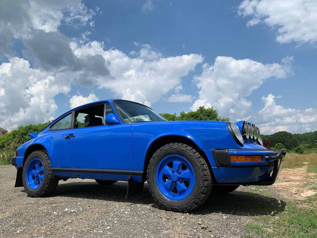 ground view of a Custom Built 1988 Porsche 911 Carrera in Acid Blue with Dog fabric interior