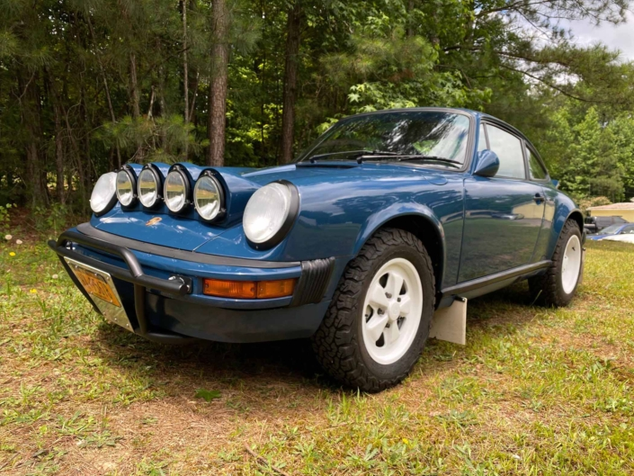 3/4 front view of a Custom Built 1987 Porsche 911 Carrera with Aga Blue exterior and Carrera fabric interior