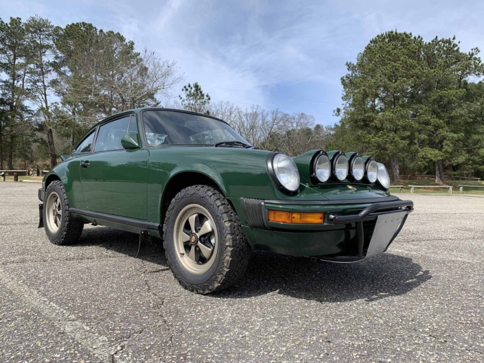 3/4 frontal view of a Custom built 1982 Porsche 911 SC in Irish Green with VW tartan interior