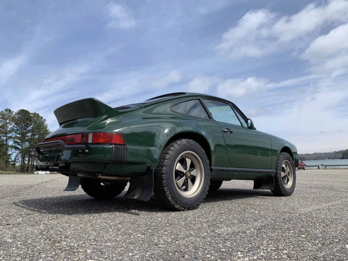 3/4 rear view of a Custom built 1982 Porsche 911 SC in Irish Green with VW tartan interior