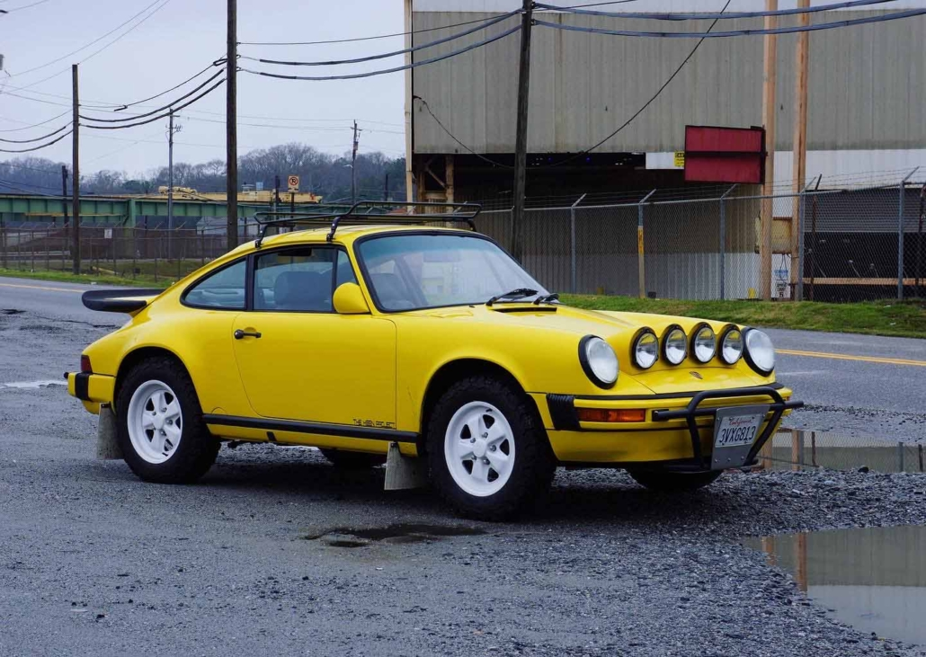 side view of a Custom Built 1988 Porsche 911 Carrera with Cadmium Yellow exterior and Opel fabric interior