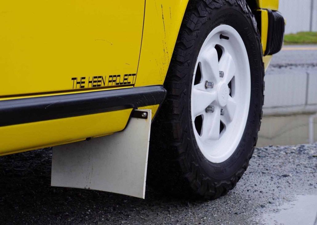 tire shot of a Custom Built 1988 Porsche 911 Carrera with Cadmium Yellow exterior and Opel fabric interior
