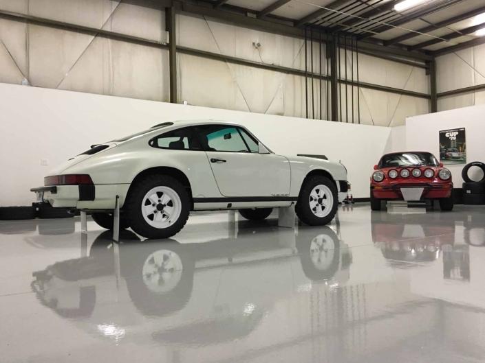 Custom Built Carrera White 1989 911 Carrera with Porsche Tartan Interior parked in a garage