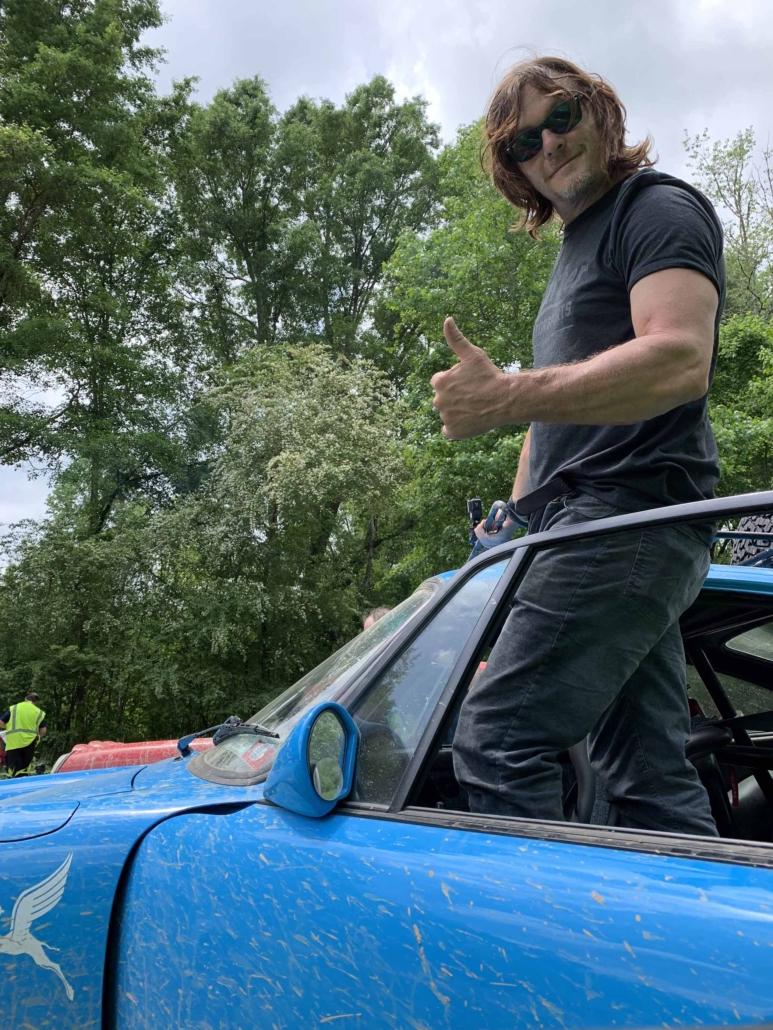 man giving thumbs up standing in a Custom Built 1980 Porsche 911 SC in Riviera Blue