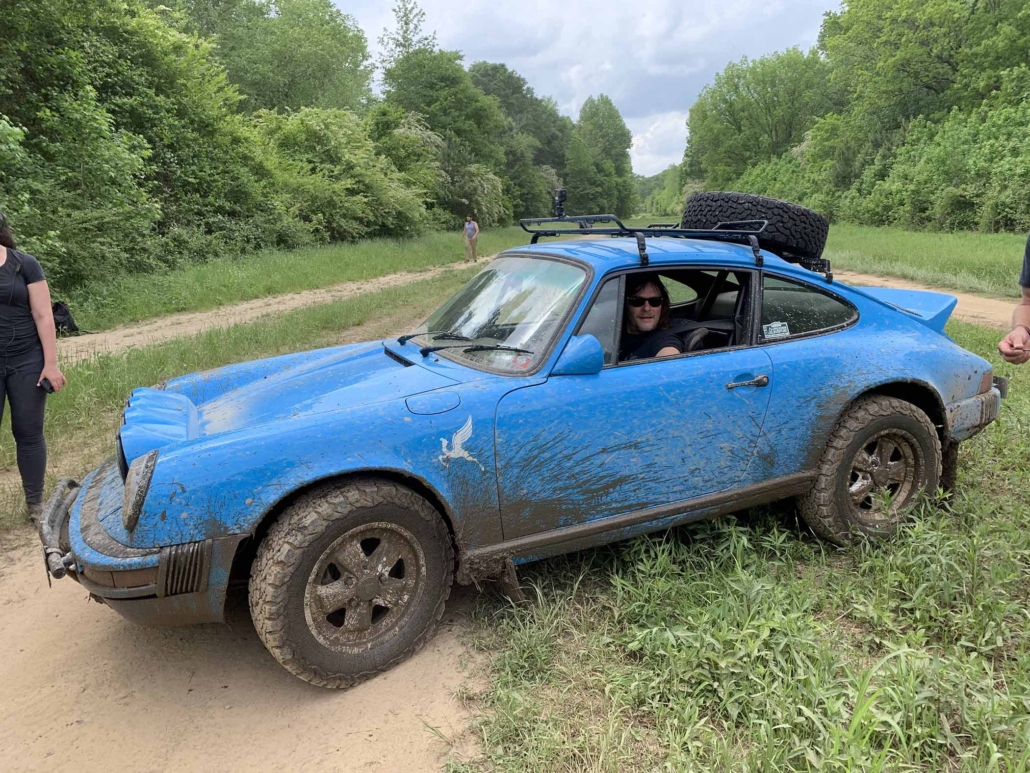 side view of a Custom Built 1980 Porsche 911 SC in Riviera Blue after driving through mud