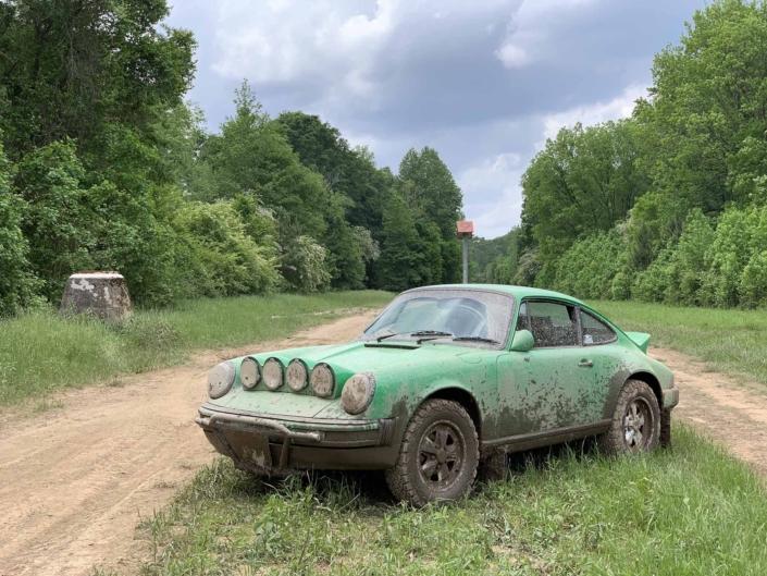 Custom Built 1981 Porsche 911 SC in Signal Green with Porsche Tartan Interior after driving through the mud