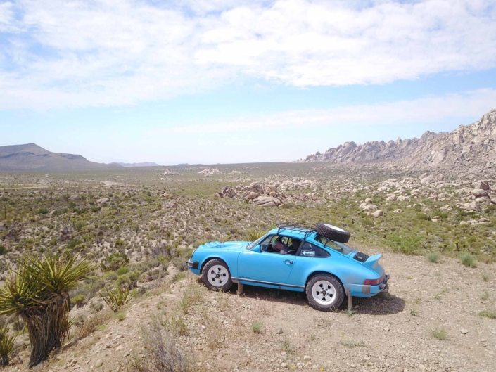 Custom Built 1980 Porsche 911 SC in Riviera Blue parked in the desert