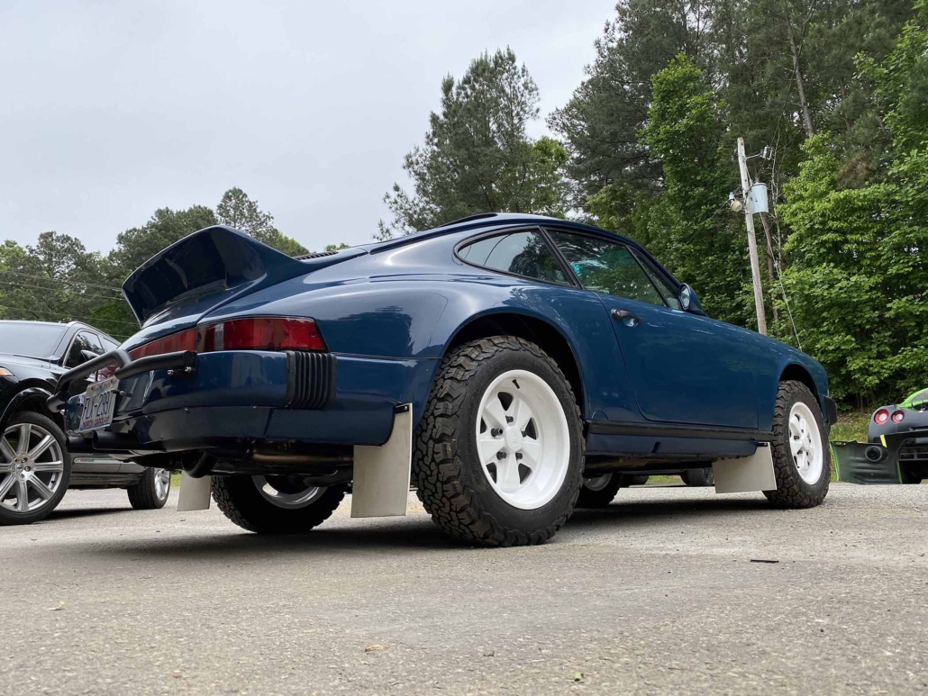 rear view of a Custom Built 1987 Porsche 911 Carrera with Aga Blue exterior and Carrera fabric interior