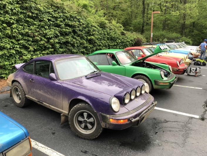Custom Built 1978 Porsche 911 SC with Lilac exterior and Pascha interior parked in a lineup of Custom Porsche's