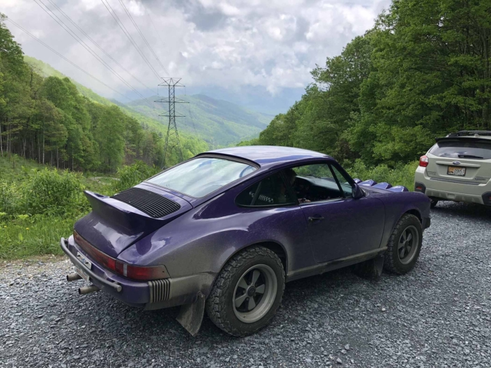 side view of Leh Keen's Custom Built 1978 Porsche 911 SC with Lilac exterior and Pascha interior